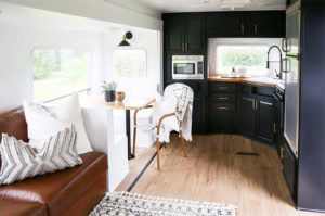 Tour this kid-friendly modern rustic camper created by a husband and wife design team, @Joinery&DesignCo! Featured on MountainModernLife.com #camperreno #campermakeover #camperremodel #tinyhometour #modernrustic