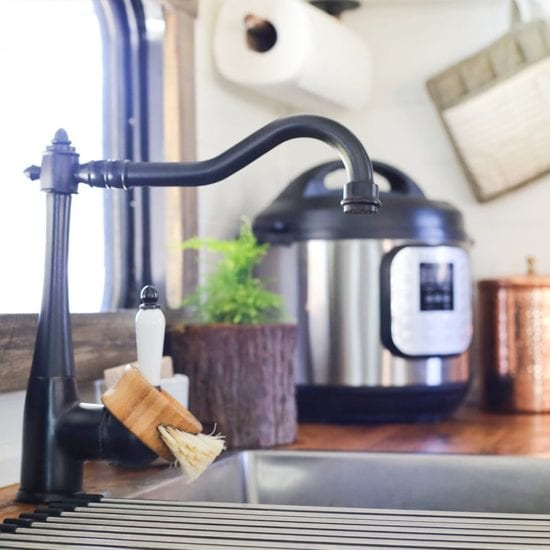 RV kitchen with black faucet