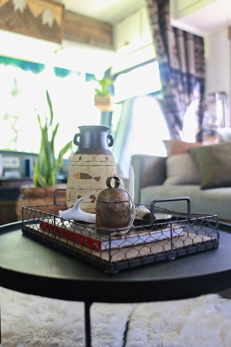 RV interior with folding coffee table and vintage finds