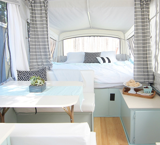 This pop-up camper makeover is bright, airy, and ready for summer! Photo from Rice Camp Blog   Featured on MountainModernLife.com
