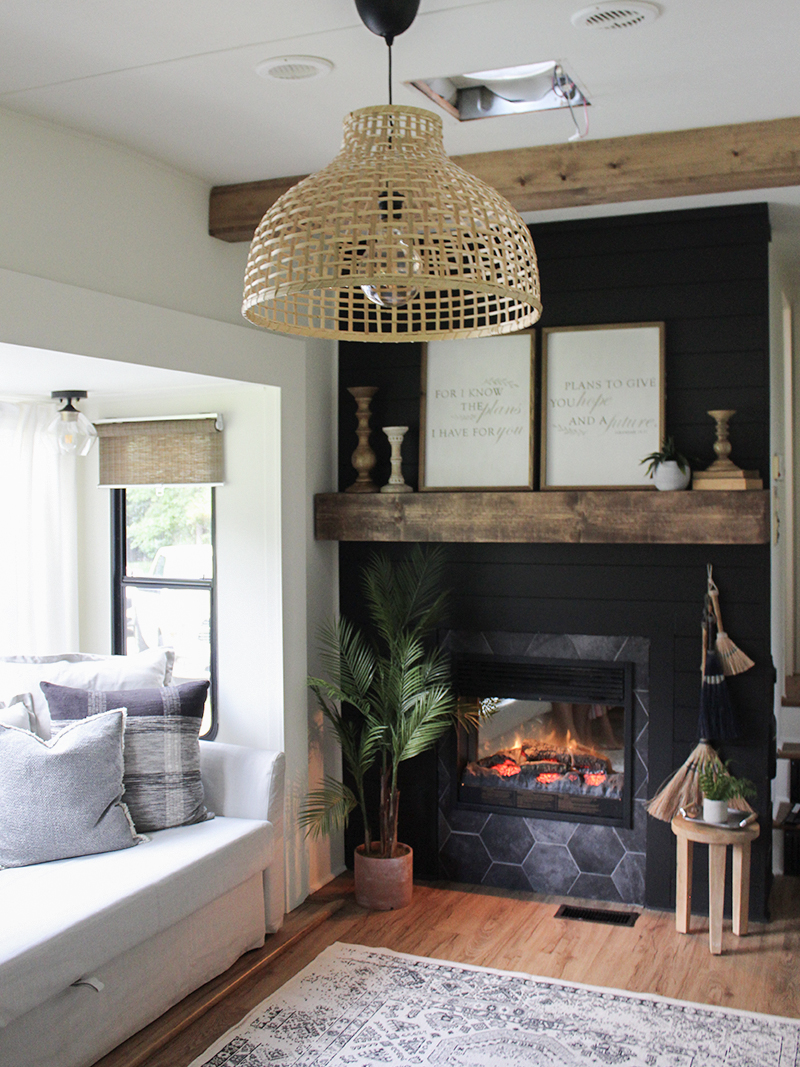 This remodeled RV has the coziest fireplace you've ever seen in a tiny home. Featuring @karleeandweston on MountainModernLife.com