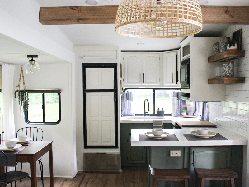This remodeled RV has the coziest fireplace you've ever seen in a tiny home (and it's for sale!). Featuring @karleemmarsh on MountainModernLife.com