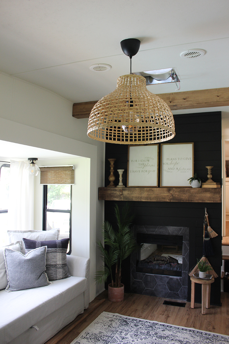 This remodeled 5th wheel has the coziest fireplace you've ever seen in a tiny home (and it's for sale!). Featuring @karleemmarsh on MountainModernLife.com