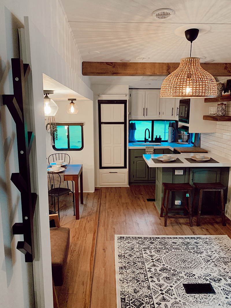 This remodeled 5th wheel has the coziest fireplace you've ever seen in a tiny home. Featuring @karleeandweston on MountainModernLife.com