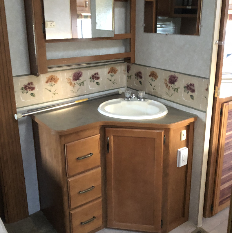 Outdated Fifth Wheel before reno from from @fifthwheelfarmhouse