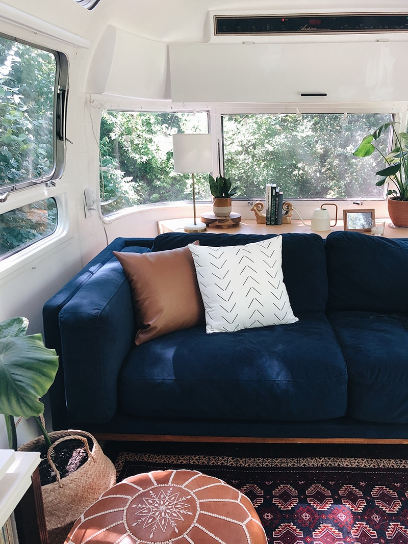 Modern Blue suede sofa inside Airstream from @provencher_adventure