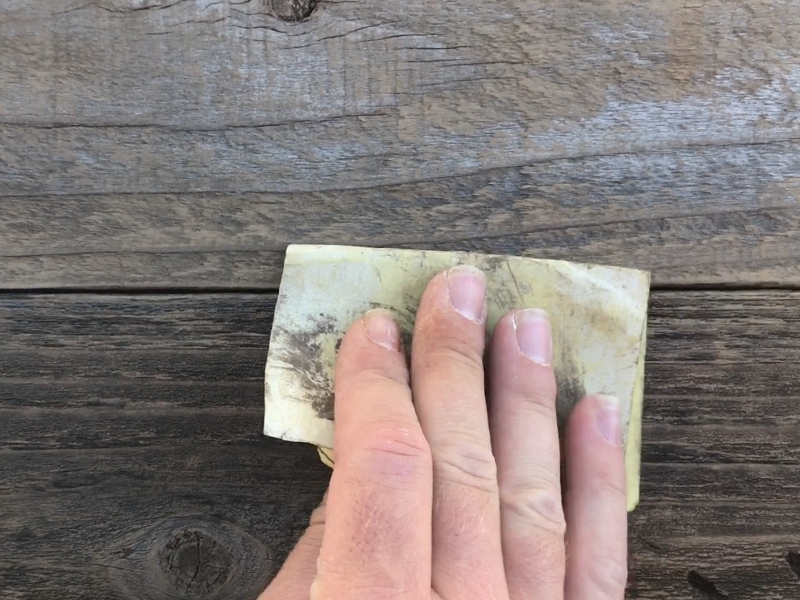 Cleaning reclaimed wood with sandpaper | mountainmodernlife.com