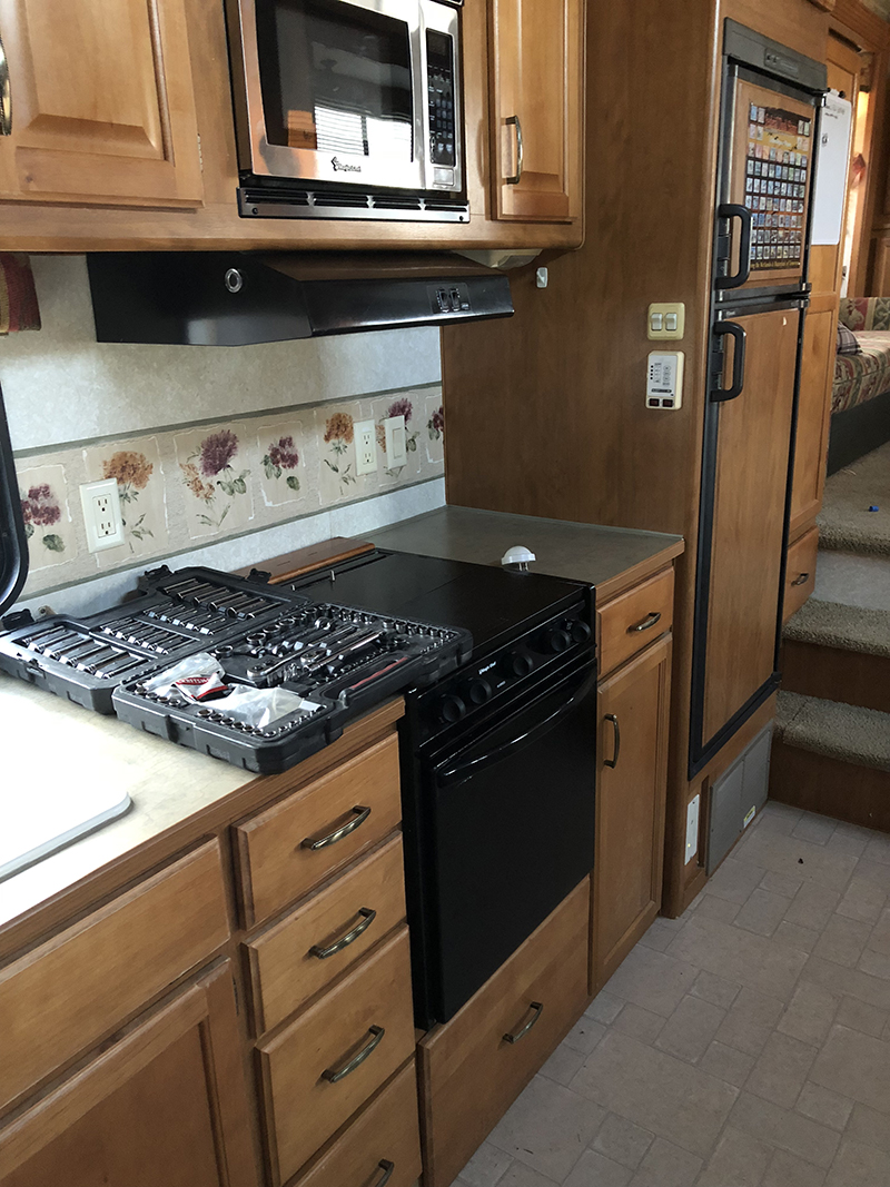 Outdated 5th Wheel Kitchen before reno from from @fifthwheelfarmhouse