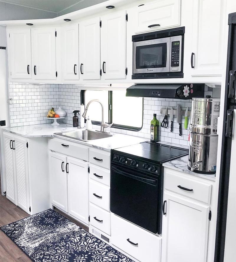 White RV Kitchen Interior from @fifthwheelfarmhouse