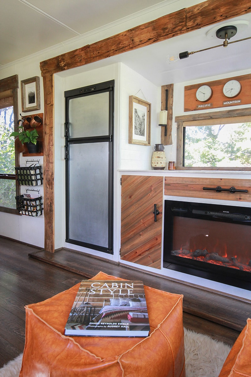 Rustic RV interior with fireplace