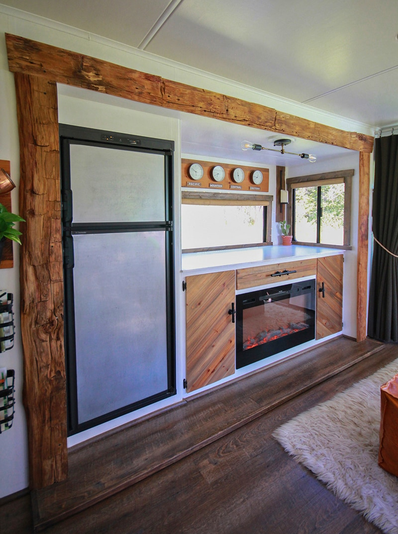 Rustic RV with hand-hewn barnwood around slide-out