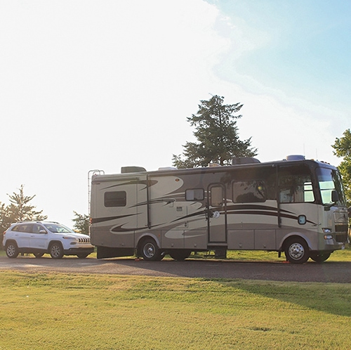 Full-time-freedom-week-featured-image-rv-with-car-behind
