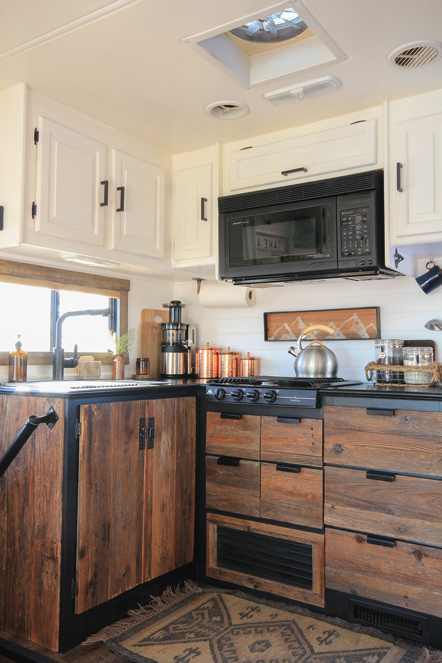 Rustic Modern RV with black countertops | MountainModernLife.com
