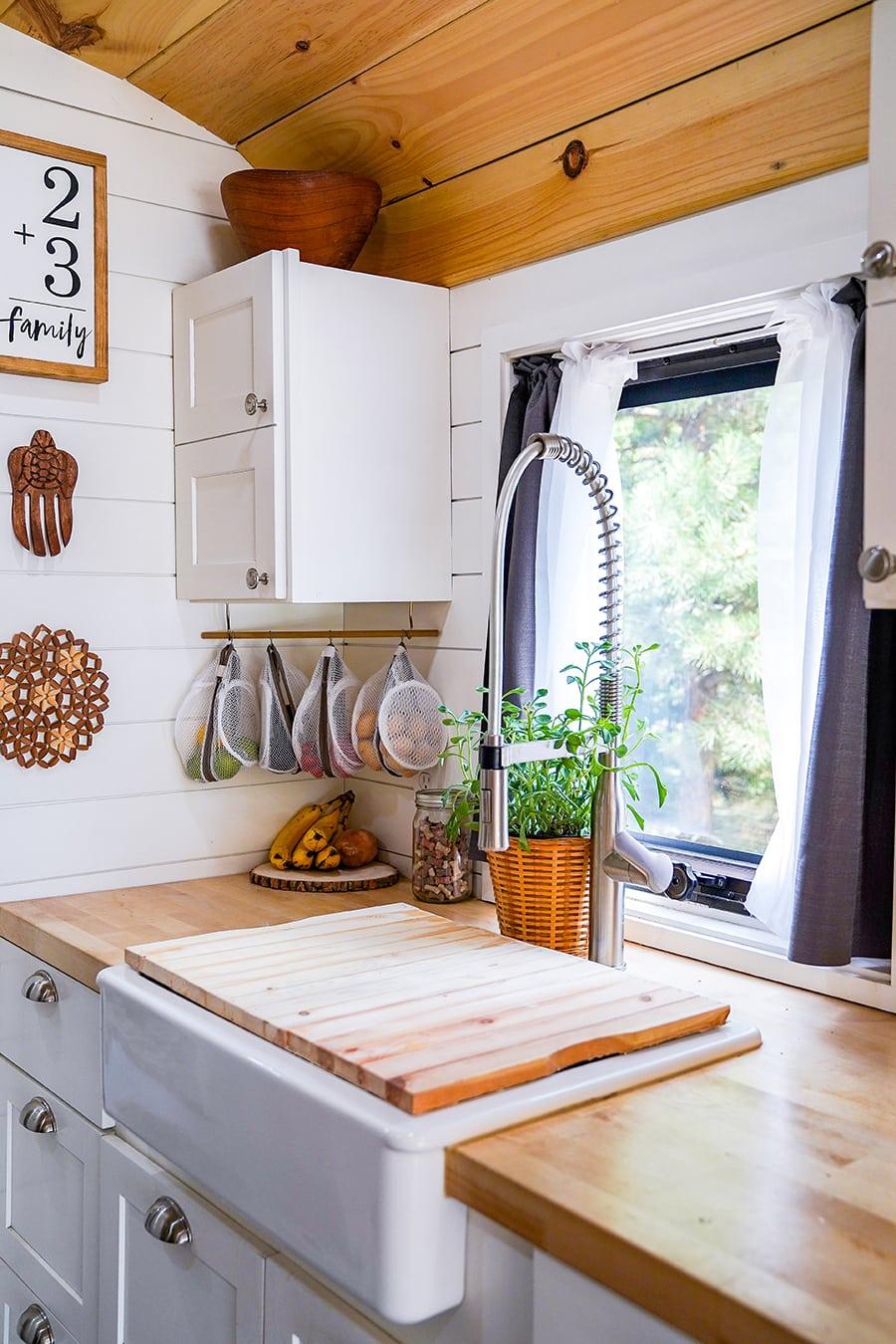 Modern tiny kitchen inside school bus @happyhomebodies