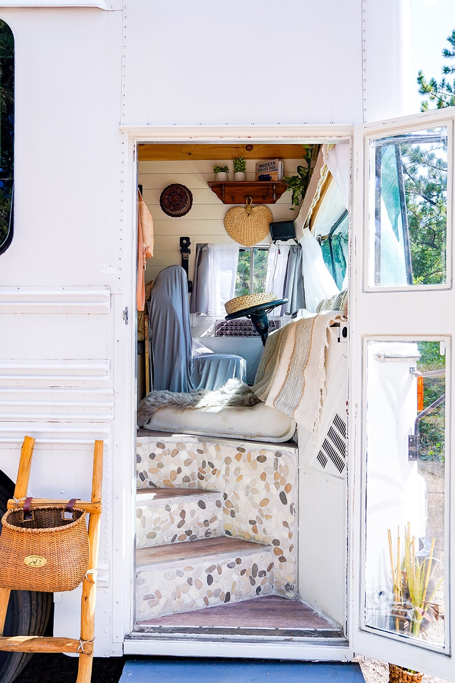 school bus converted into tiny home on wheels @happyhomebodies