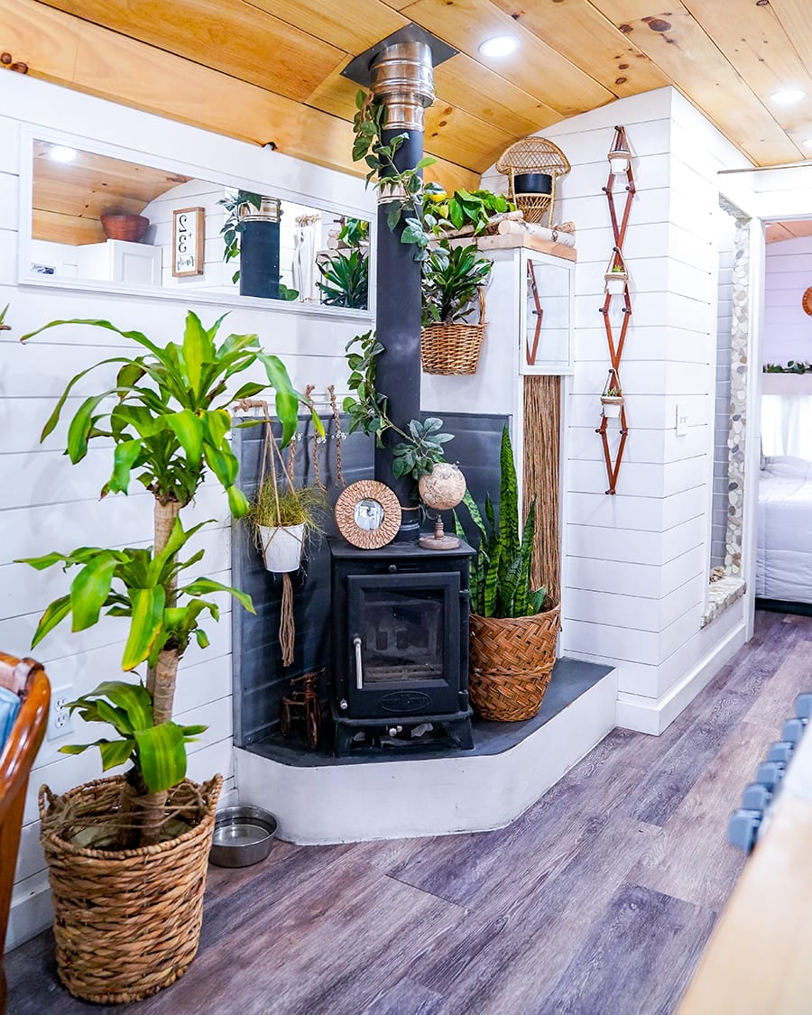 converted school bus with wood burning fireplace @happyhomebodies
