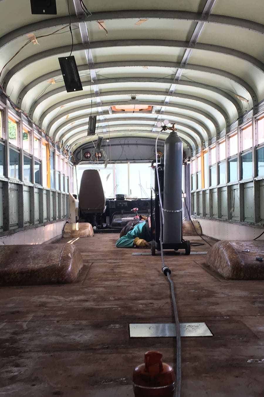 converting school bus into tiny home