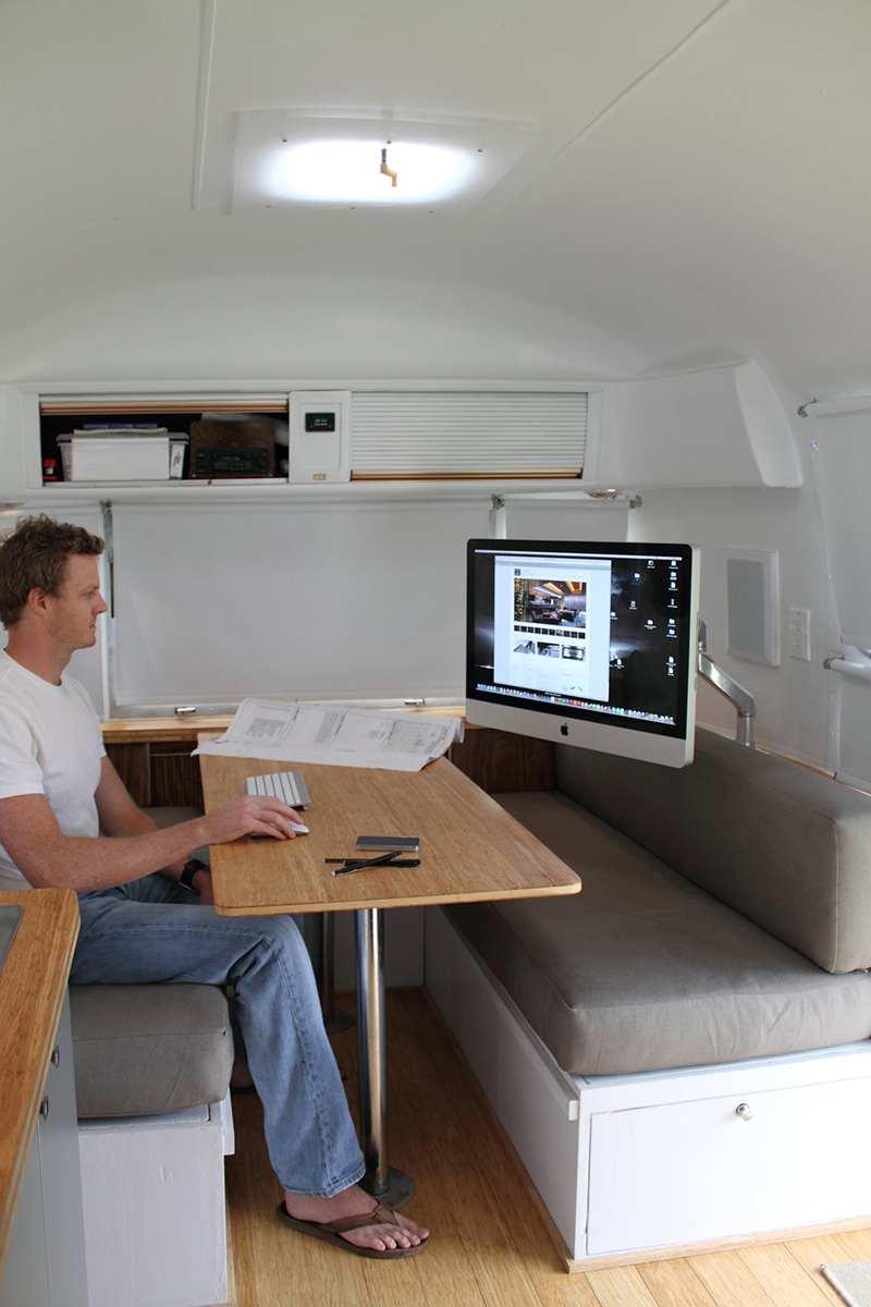 Airstream office with Mac attached to wall