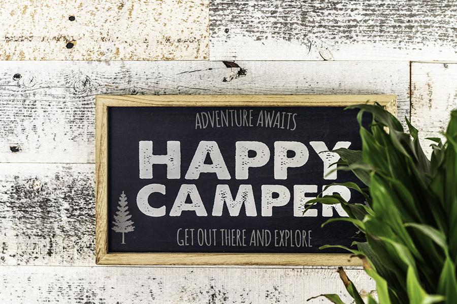 Happy Camper sign inside travel trailer