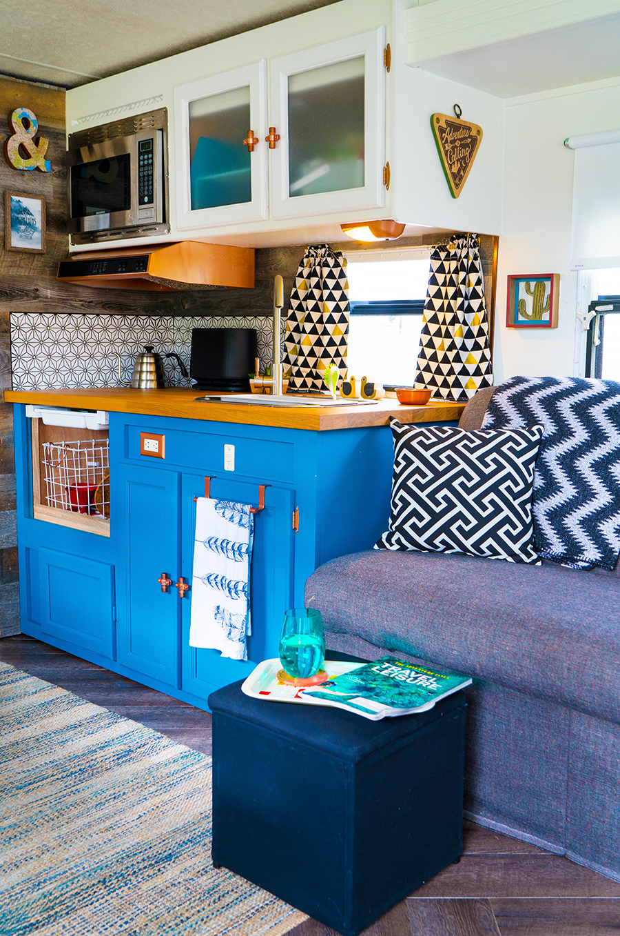 camper kitchen with blue cabinets