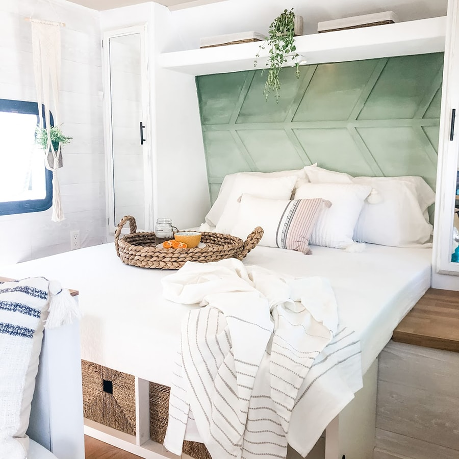 Green accent wall in modern RV bedroom
