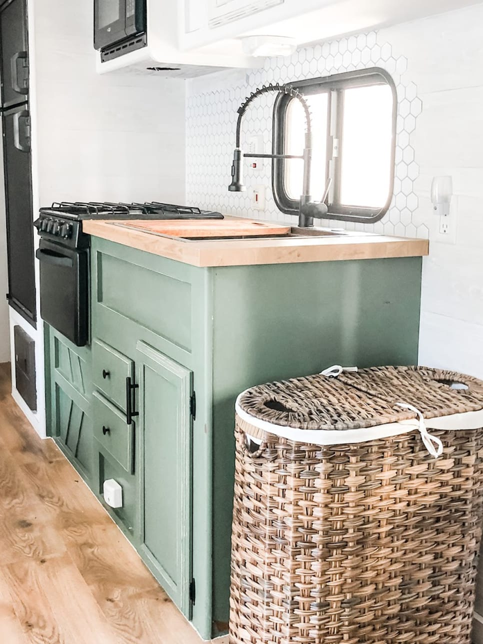 RV kitchen with green cabinets