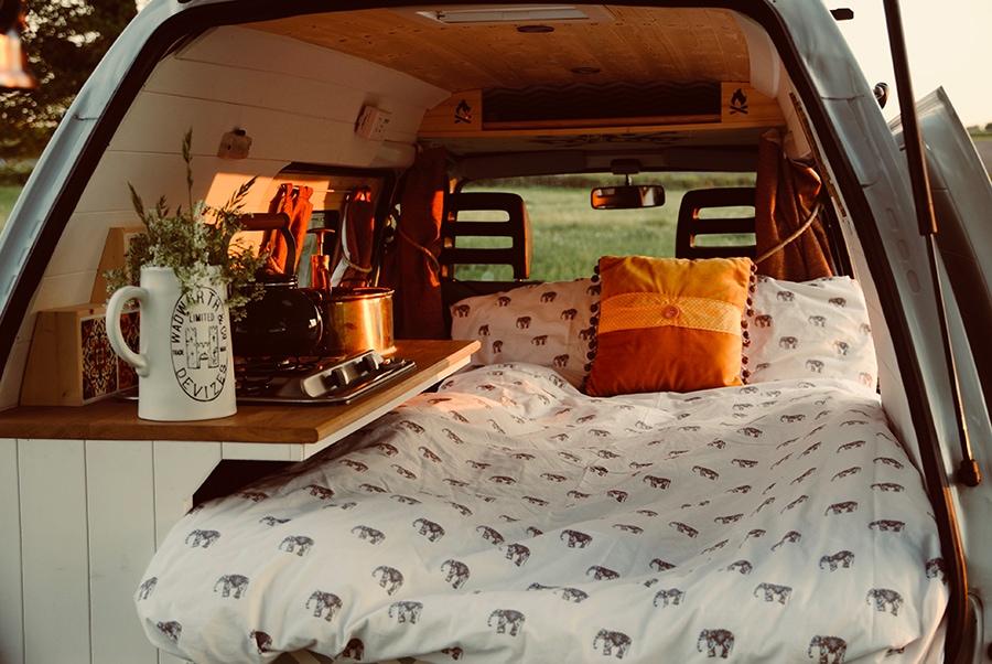 cozy bedroom inside tiny van