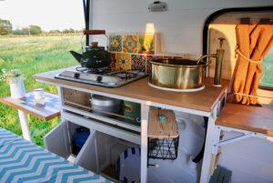 tiny kitchen inside renovated van