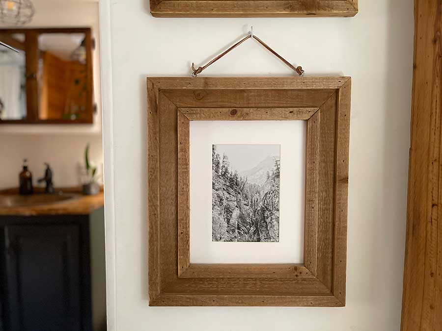 wood frame with black and white print of mountains