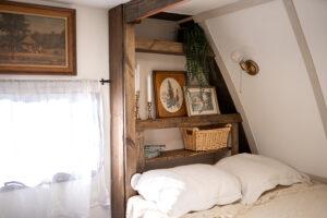 cozy vintage-inspired bed nook inside camper