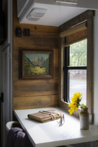 cozy rustic desk nook with cabin oil painting