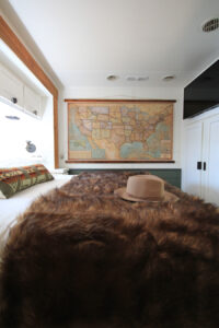 RV bedroom with vintage map