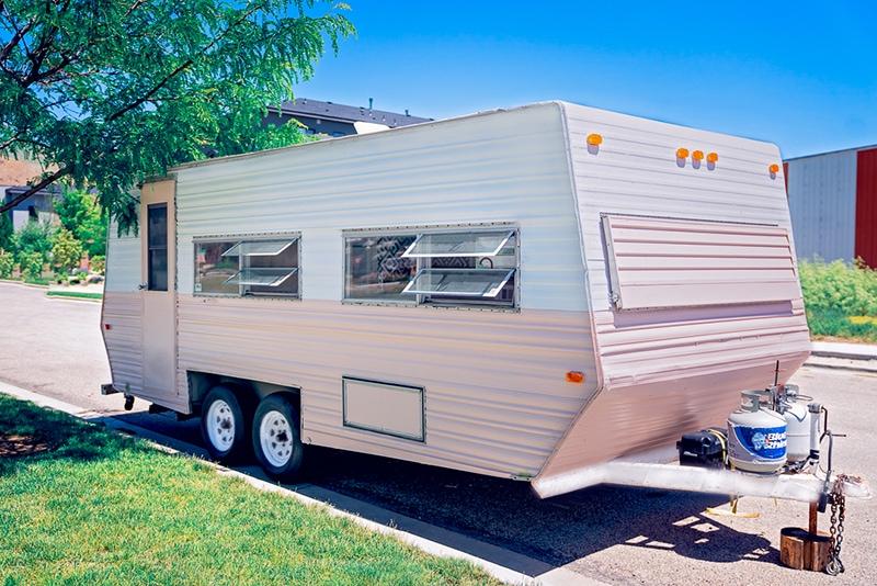 pink and white vintage camper exterior