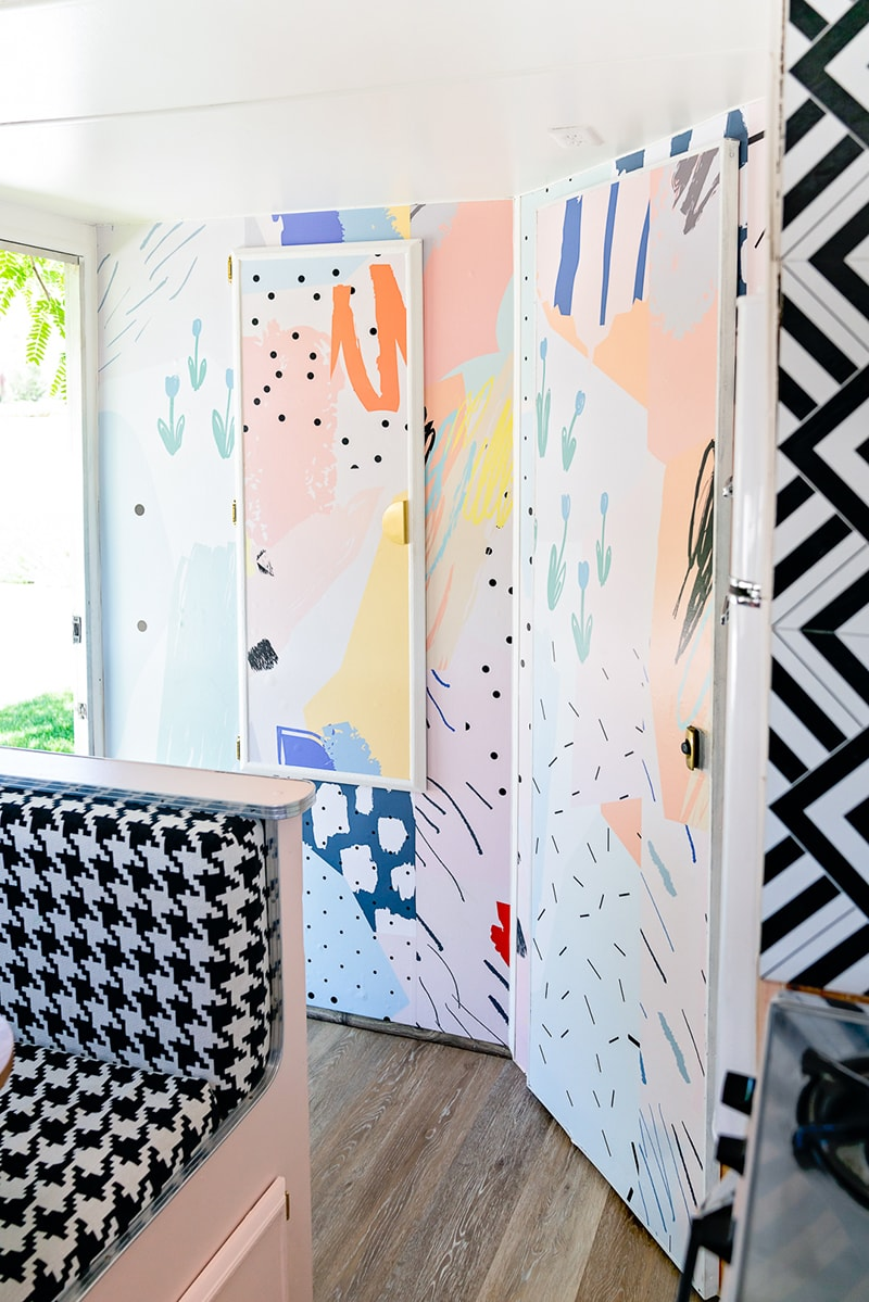 The playful interior of this vintage camper renovation was inspired by abstract pop wallpaper