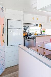 colorful camper with vintage inspired fridge