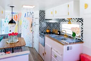 vintage camper with pink kitchen cabinets