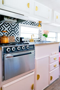 camper oven and pink kitchen cabinets