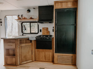 travel trailer kitchen remodel with unpainted cabinets