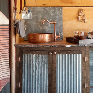 western camper kitchen with copper sink and corrugated metal