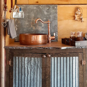 rustic camper kitchen with copper sink and corrugated metal