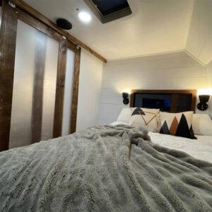 camper bedroom remodel with sliding doors