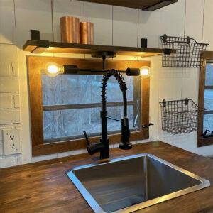 camper kitchen with framed window