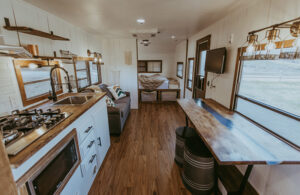 cozy camper remodel with river table