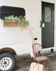 painted camper exterior with window boxes