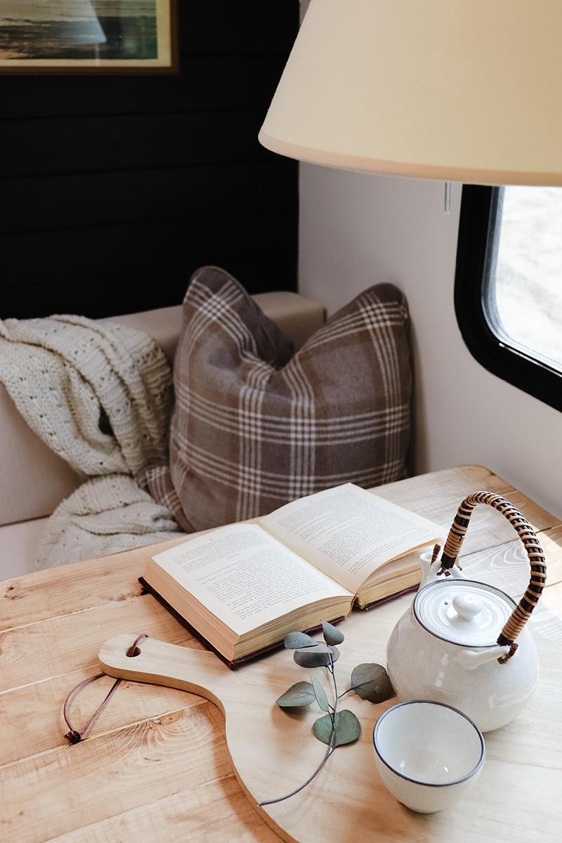 plaid pillow inside cozy camper