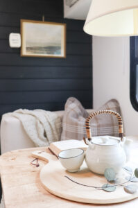 camper dinette makeover with plaid pillow